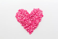 Roze die hart van kleine harten op een witte achtergrond wordt gemaakt Royalty-vrije Stock Afbeeldingen