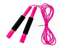 Roze die springtouw of touwtjespringen op witte achtergrond wordt geïsoleerd Stock Foto