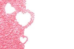 Roze die suikergoed als harten wordt gevormd op wit worden geïsoleerd stock afbeelding