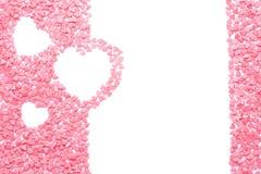 Roze die suikergoed als harten wordt gevormd op wit worden geïsoleerd stock fotografie