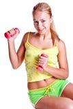 Roze domoren in de handen van vrouwen Stock Foto's