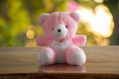 Roze draag Doll bokeh achtergrond Stock Fotografie