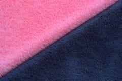 Roze en grijze bontachtergrond stock foto's