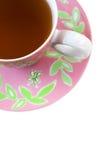 Roze en groene theekop en schotel Stock Afbeeldingen