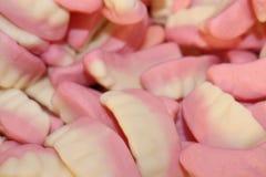 Roze en witte banketbakkerijtanden stock foto