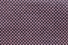 Roze en zwarte textielachtergrond met schaakpatroon, close-up Structuur van de stoffenmacro Royalty-vrije Stock Afbeelding