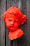 Roze engelengezicht, beeldhouwwerk Stock Afbeeldingen