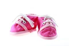 Roze geïsoleerde babyschoenen royalty-vrije stock foto's