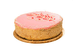 Roze geïsoleerde cake stock afbeeldingen