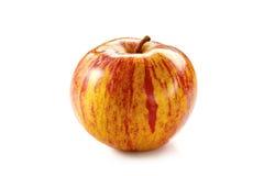 Roze gestreepte appel op wit Stock Fotografie