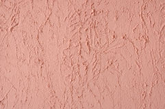 Roze gipspleistermuur. Stock Fotografie