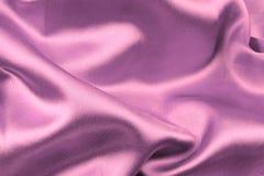 Roze golvende zijdestof Stock Foto's