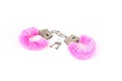 Roze handcuffs Stock Foto's