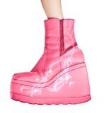 Roze laarzen die op wit worden geïsoleerdu Stock Foto