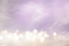 roze, lichtpaarse en zilveren abstracte bokehlichten stock fotografie