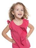 Roześmiana preschool dziewczyna przeciw bielowi Obraz Stock