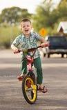 Roześmiany dziecko na rowerze Obraz Royalty Free