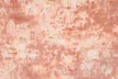 Roze muur van pleister stock foto's