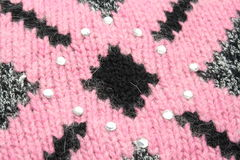 Roze patroon op zwarte sweater Stock Foto