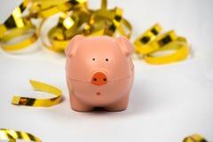 Roze Piggy met Gouden Document Wimpels Stock Foto