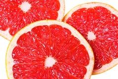 Roze sappige grapefruitplakken royalty-vrije stock fotografie