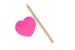 Roze sticker en gouden potlood Stock Fotografie