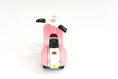 Roze stuk speelgoed motorfiets Stock Foto