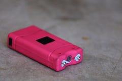 Roze Taser Stock Foto