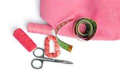 Roze toebehoren met stof Stock Afbeelding