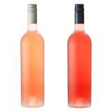 Roze wijnflessen op wit Stock Afbeelding