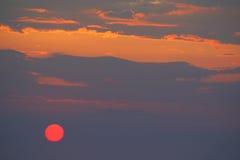 Roze Zon in Zonsondergang Stock Afbeelding