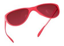 Roze zonnebril met gekleurde vensters in het plastic kader Stock Fotografie