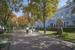 Rozhdestvensky Boulevard in the fall with worship cross in memor stock photography