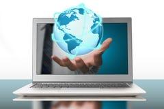 Rozjarzona orbity kula ziemska w plama przez laptopu Zdjęcie Stock