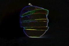 Rozjarzona pomarańcze, cytryna i jabłko w czarnym tle, obraz royalty free