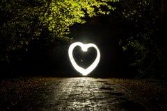 Rozjarzony serce w ciemności Freezelight Fotografia Royalty Free