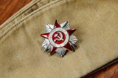Rozkaz Patriotyczna wojna w St na żołnierzu furażuje nakrętkę z bliska Zdjęcie Stock