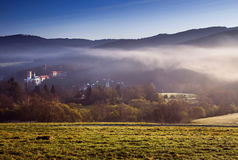 Rozmberk castle in the misty landscape. Spring morning over the Rozmberk caste royalty free stock images