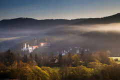 Rozmberk castle in the misty landscape. Spring morning over the Rozmberk caste stock photography