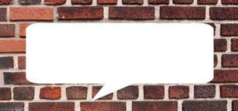 Rozmowa bąbel na ściana z cegieł zdjęcie royalty free