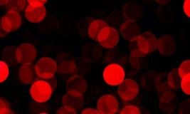 Rozmyty czerwone światło okrąża jarzyć się w zmroku zdjęcia stock