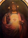 Roznava - coração de Jesus Christ ressuscitado pelo pintor Tichy do ano 1926 na sacristia da catedral Fotos de Stock Royalty Free