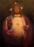 Roznava - coração de Jesus Christ ressuscitado pelo pintor Tichy do ano 1926 na sacristia da catedral imagens de stock