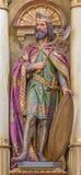 Roznava - statua scolpita della st Ladislavaus - re dell'Ungheria dall'altare principale nella chiesa di St Ann (francescani) Fotografie Stock