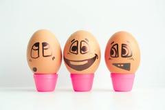 Rozochoceni jajka trzy przyjaciela, brown jajka Obrazy Royalty Free