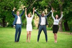 Rozochoceni koledzy stoi outside obrazy royalty free