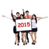 Rozochoceni ludzie biznesu chwyta liczba 2015 Obraz Stock