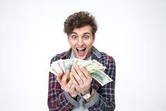 Rozochoceni młodego człowieka mienia rachunki dolary Obrazy Stock