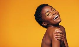 Rozochocona afrykańska kobieta z makeup Zdjęcie Royalty Free