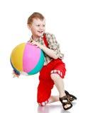 Rozochocona chłopiec w szkockiej kraty koszula zdjęcia royalty free